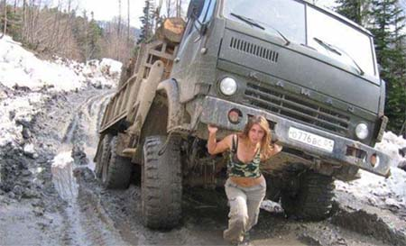 In soviet russia women pull trucks